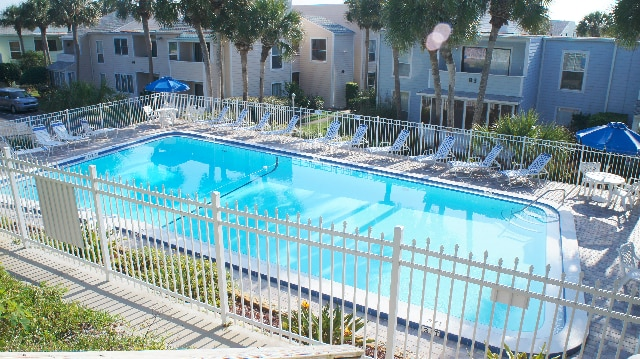 Community pool just steps outside condo door (not heated)