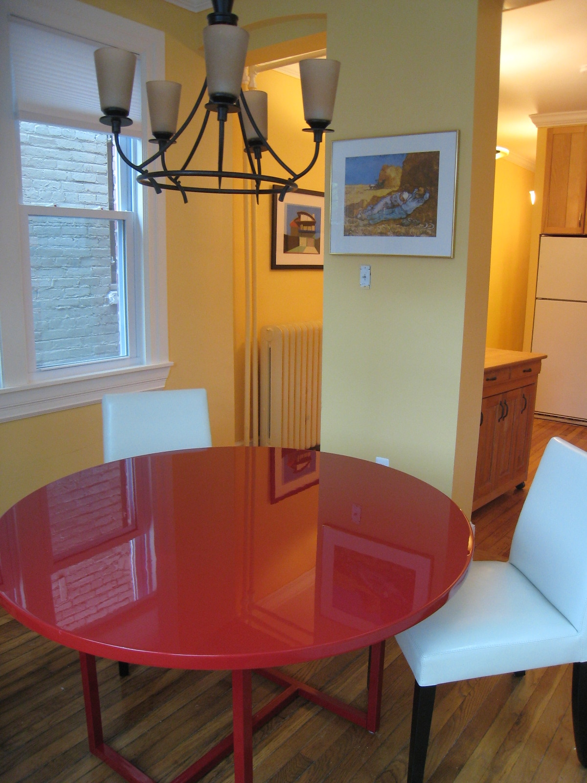 Dining room is surrounded by windows and has a view and door to the patio.