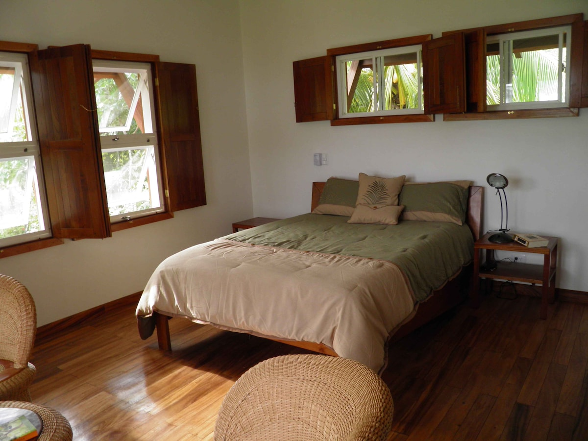 The second floor has a bedroom with a queen-size bed and a bathroom.
