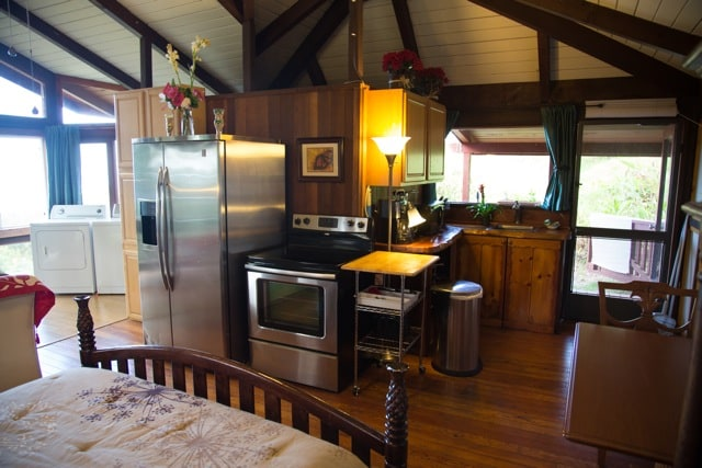 Fully equipped kitchen with oven, microwave, coffee maker, toaster and blender.