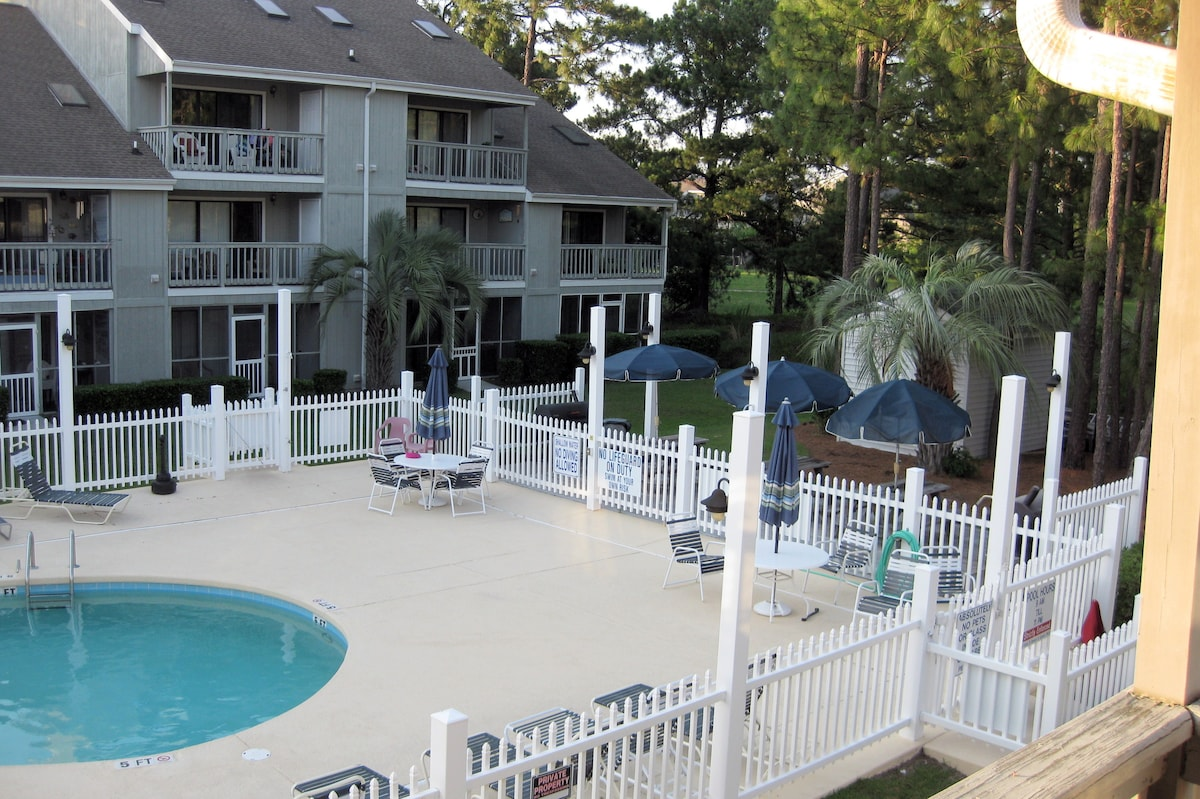 balcony view of picnic area beyond pool