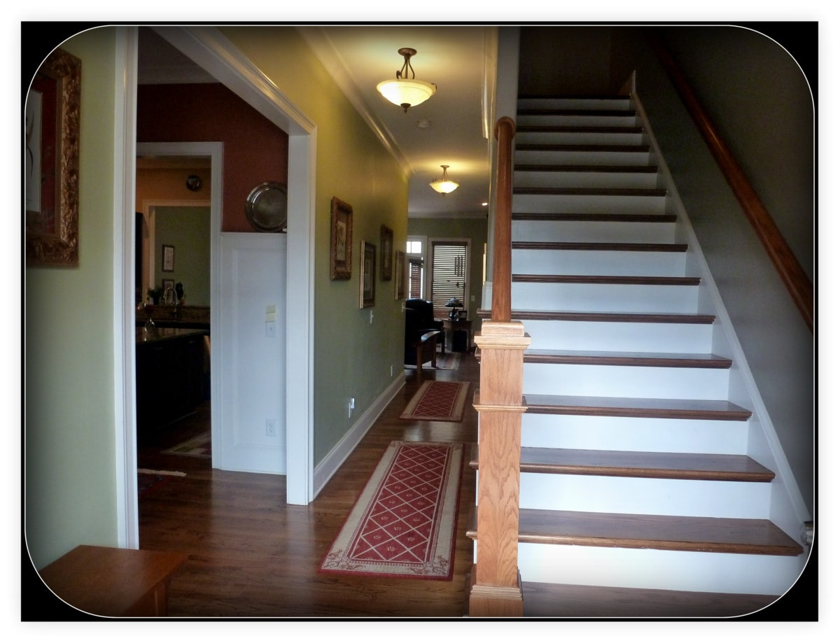 Foyer for three levels of townhouse...view of stairs which leads to second level and hallway for main level.