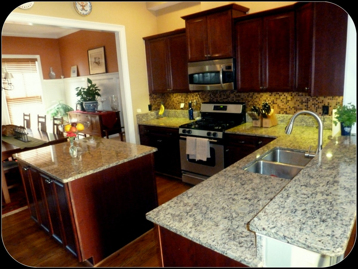 Gourmet kitchen...granite counter tops, island and stainless steel appliances