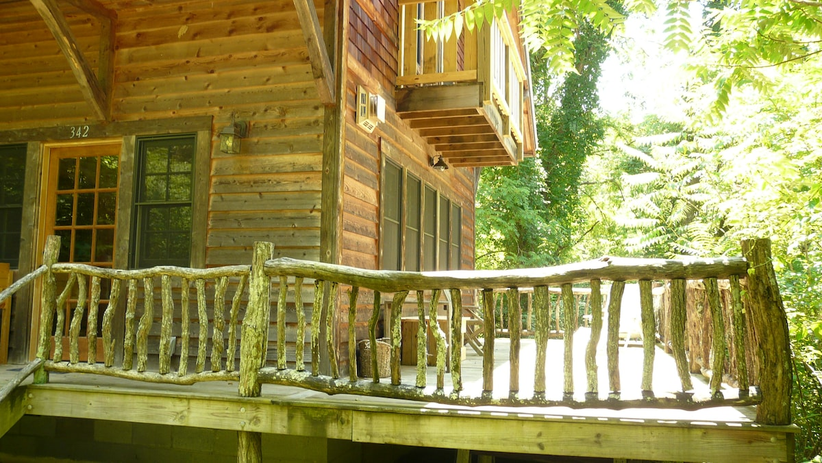 Enjoy the sounds of nature from the wrap-around porch.