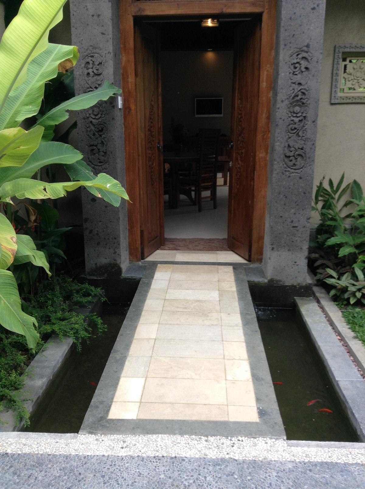 Walk over the coy pond, your fabulous villa awaits!