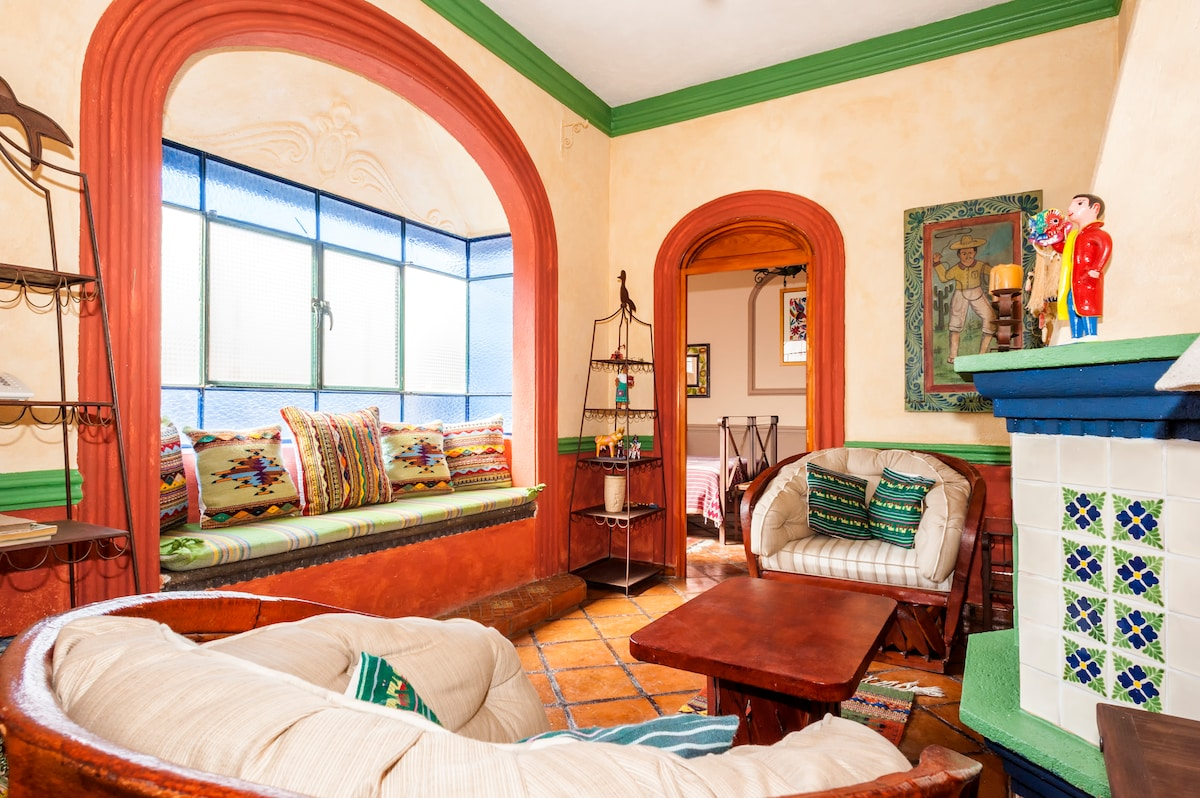 Living room showing the large windo with window seat