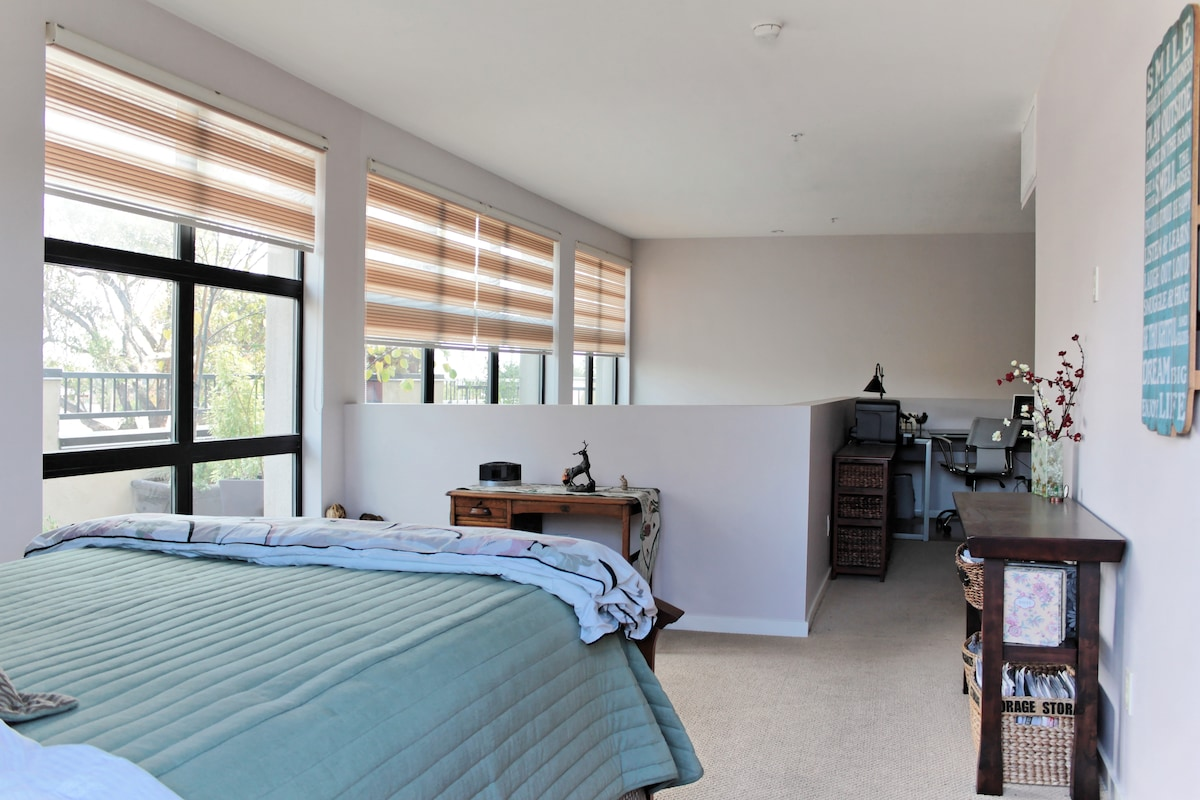 Bedroom with side view of balcony.