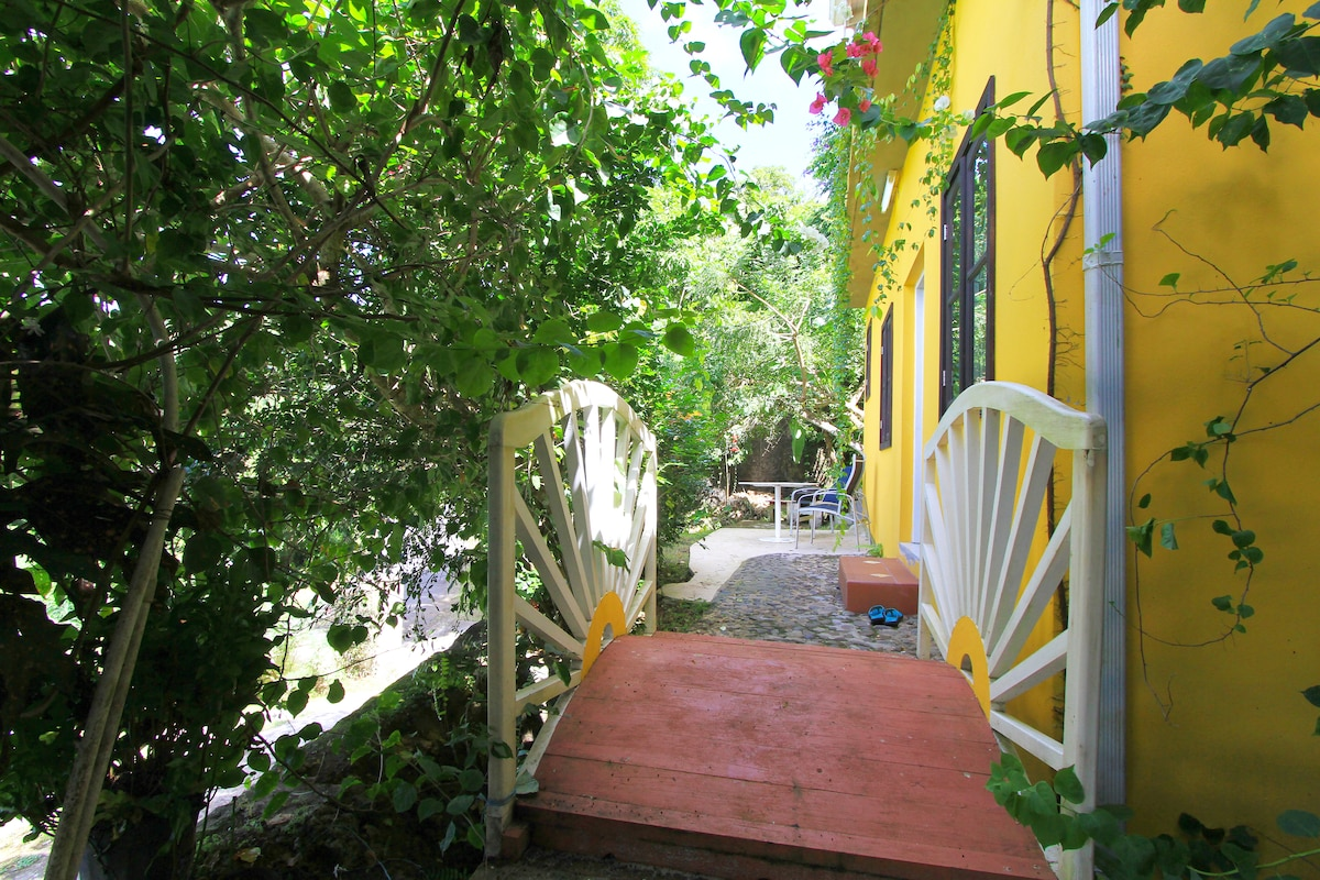 Private entrance via charming bridge: privacy next to the hosts' house