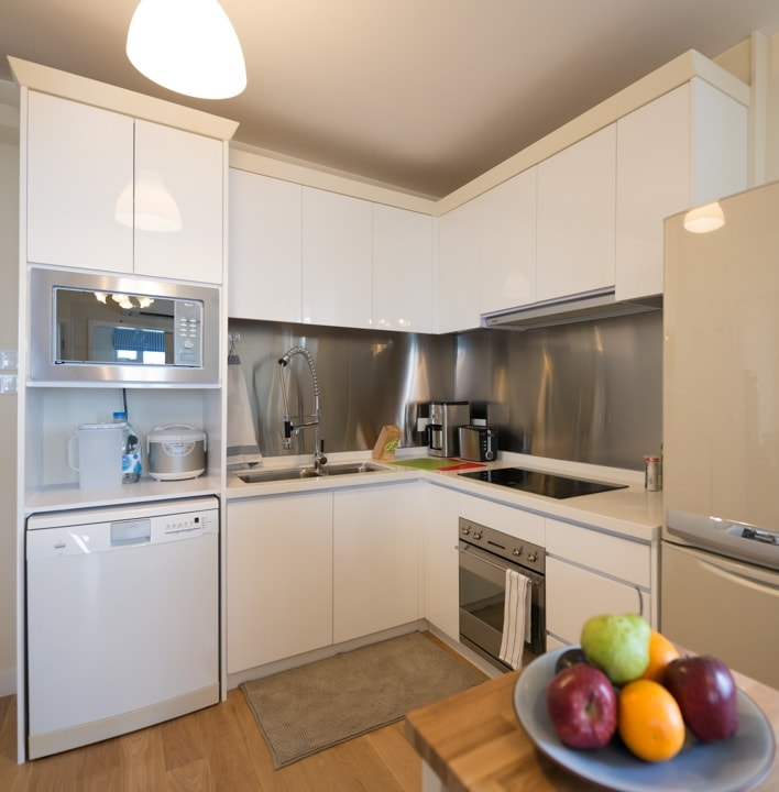 Fully equipped open plan kitchen that includes built-in SMEG oven cooker, 2 hot plates, Whirlpool microwave cooker, AEG dishwasher, and a large fridge.