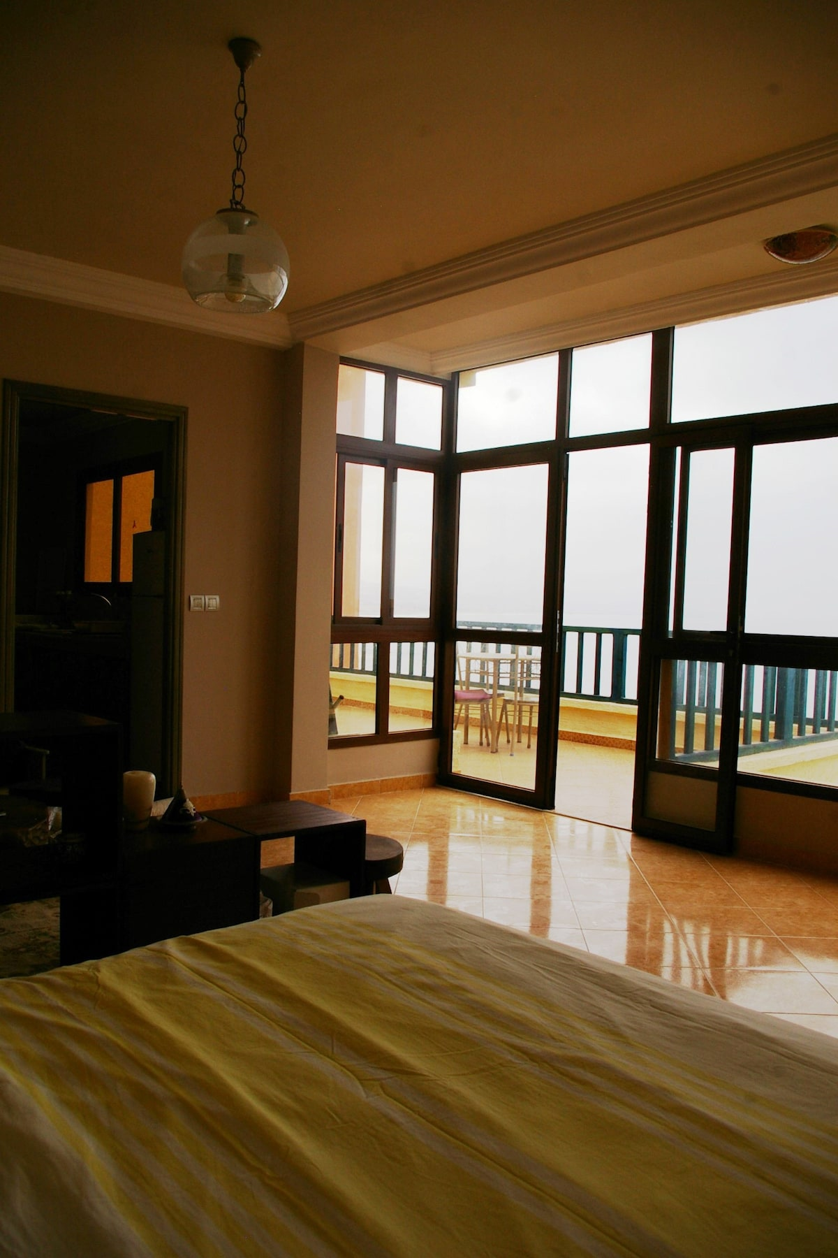 The view and terrace from the bed.