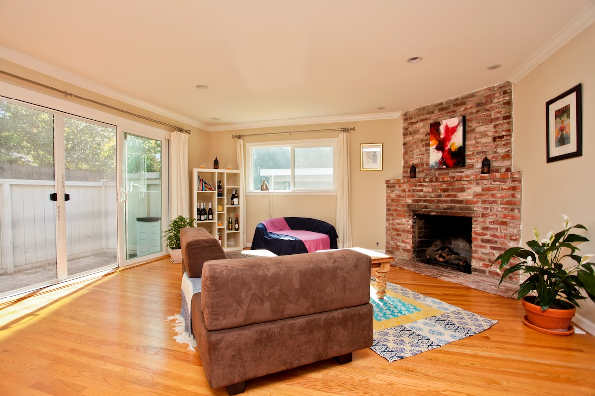 Colorful and bright apartment. Here's the Living room and fire place.