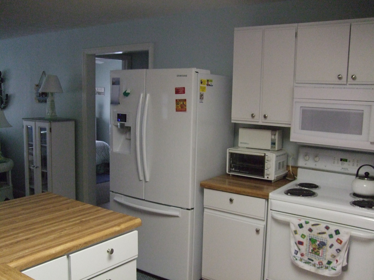Brand new Samsung French door refrigerator with water and ice.
