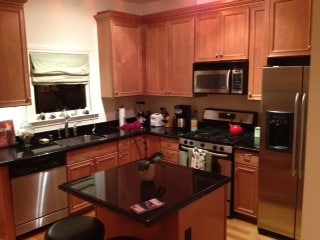 Modern kitchen with gas stove, dishwasher and coffee maker