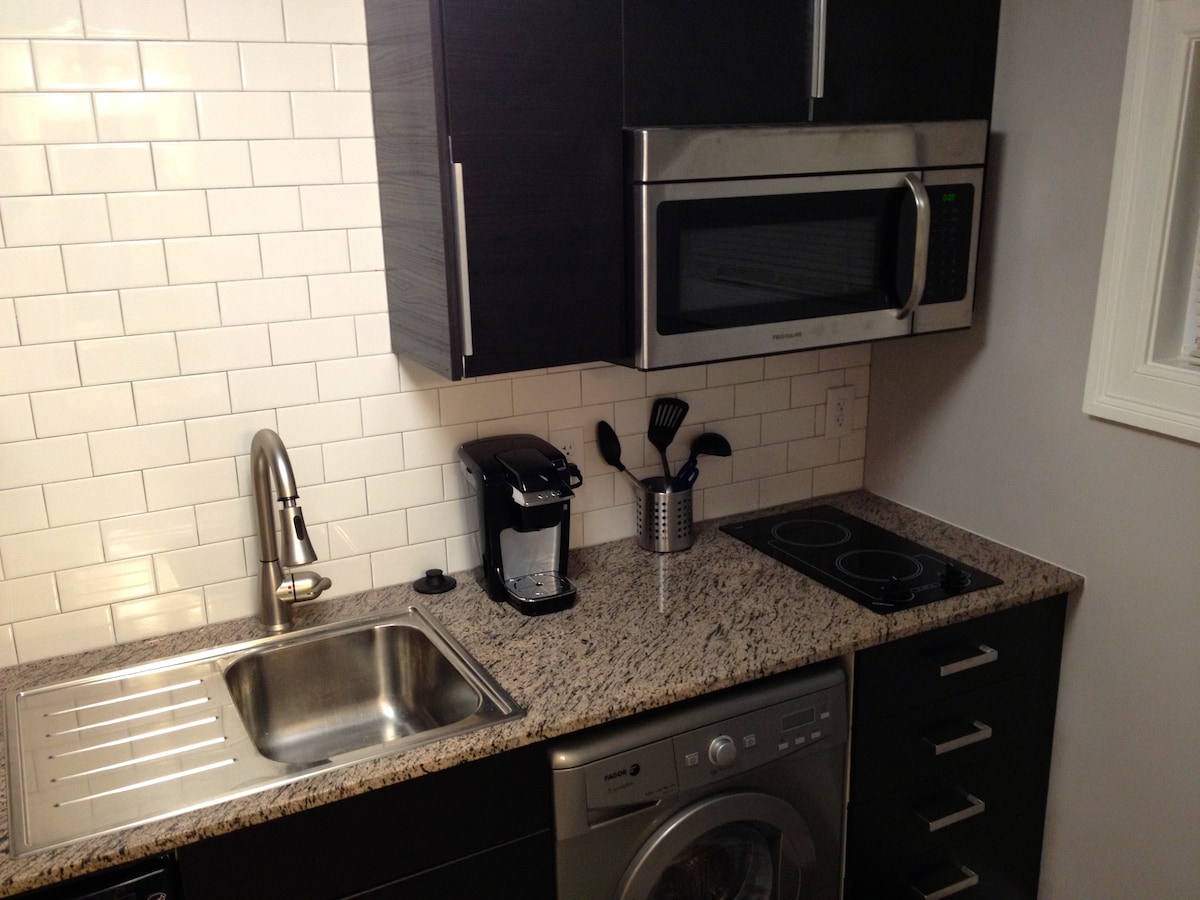 The kitchen includes a refrigerator, dishwasher, stove, microwave/convection oven, Keurig coffee maker and washer/dryer.