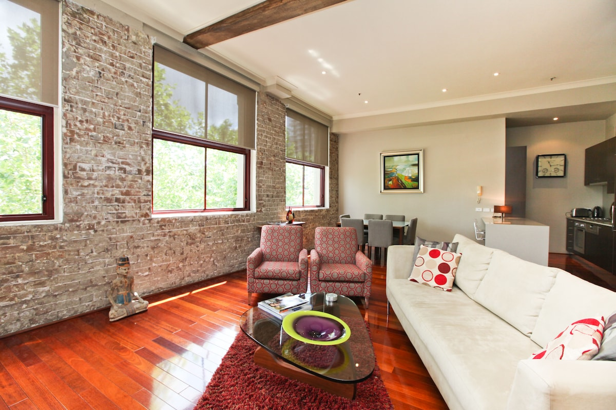 Soaring ceilings, polished floors and exposed brick