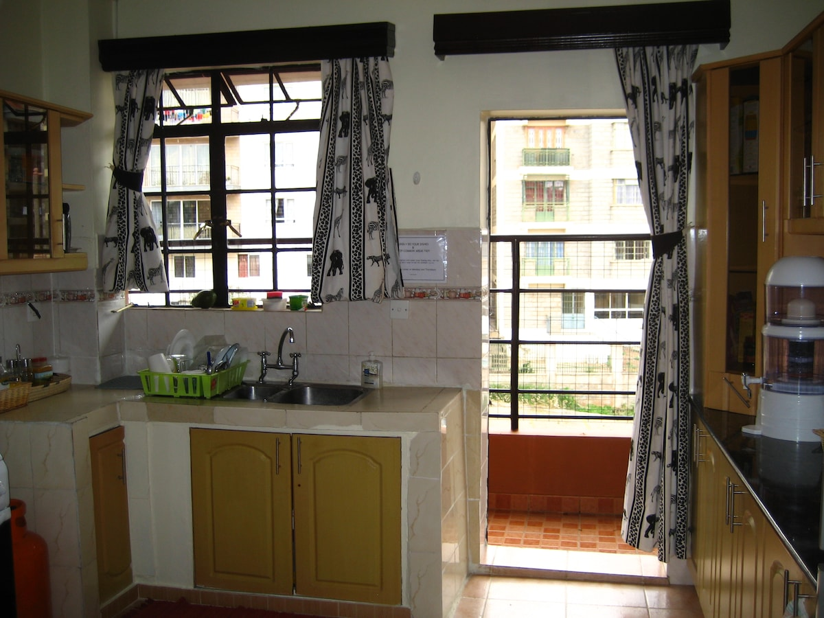 Kitchen has lovely attached balcony.