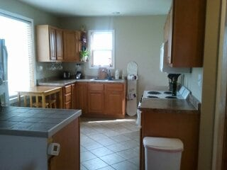 Newly remodeled fully stocked kitchen  with dishes, cookware,silverware and almost any spice you could want.