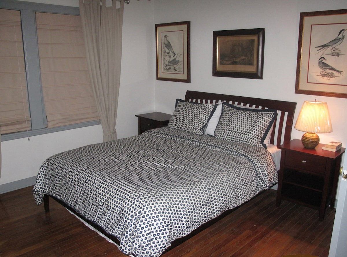 Bedroom 2 Decorated with Antique Prints. Bed is Queen Size
