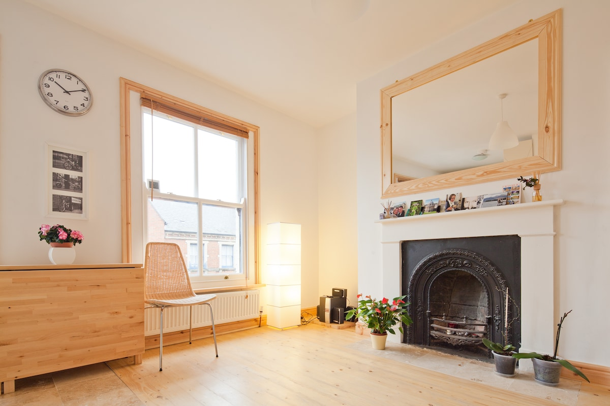 Sitting room has natural light through traditional sash windows