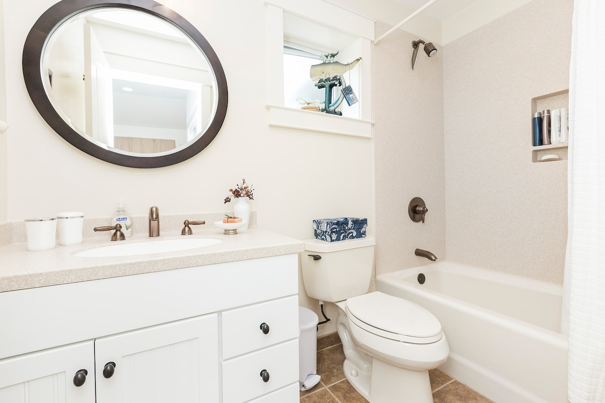 Full private bathroom with shower in tub.