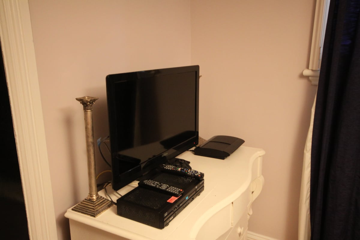 Flat screen HDTV with PS3 BluRay, HD terminal, free NETFLIX, cable and hi-speed internet.