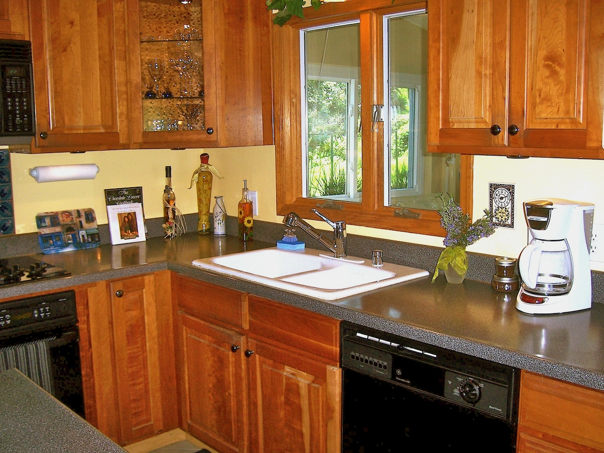 While cooking in the kitchen enjoy the view to the trees in the yard.