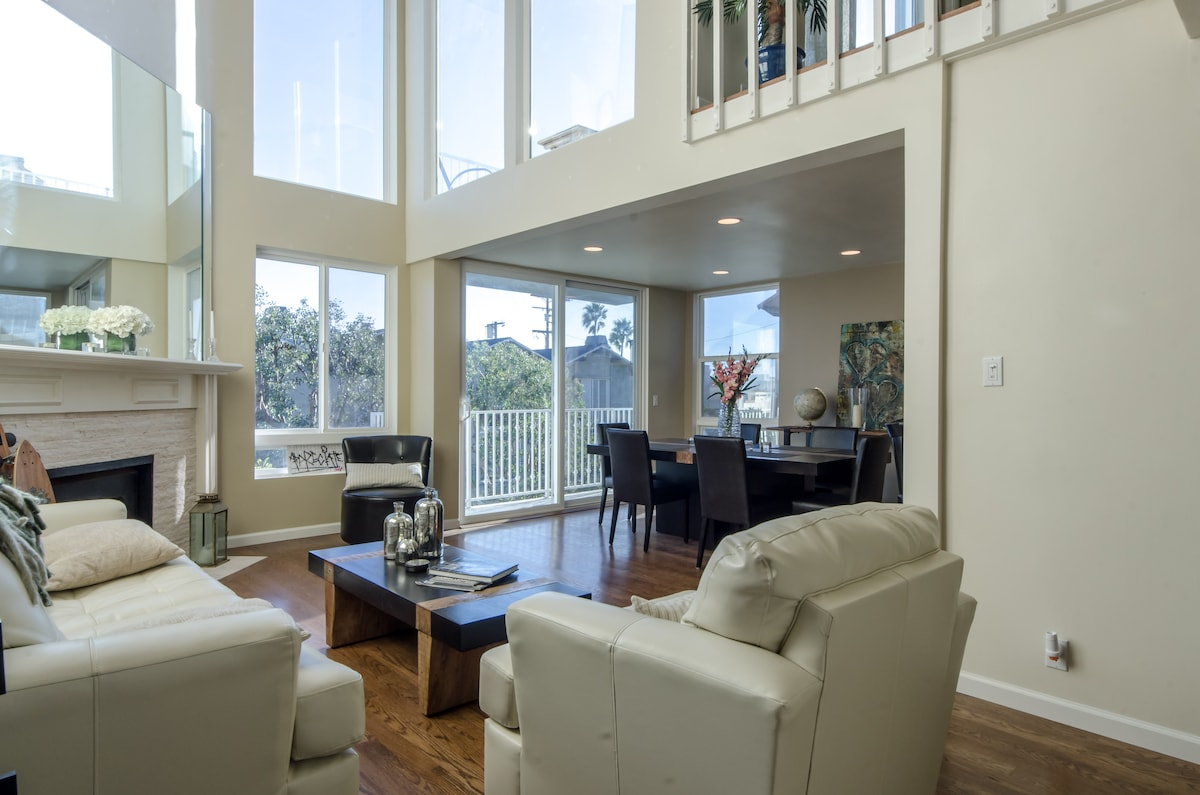 Relax in the living room while enjoying expansive blue skies