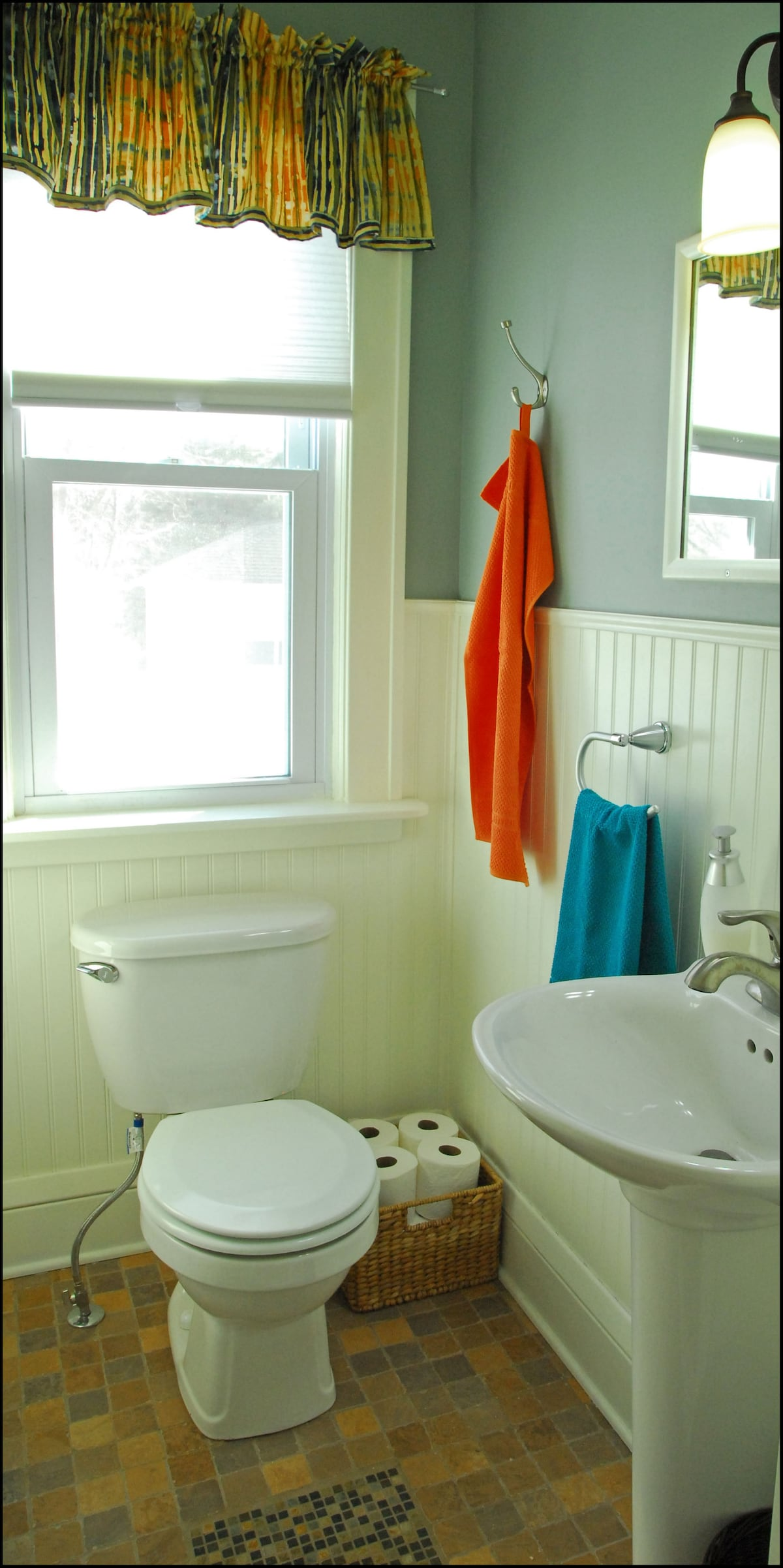 Adjacent to the kitchen and breakfast area is the 1/2 bath.