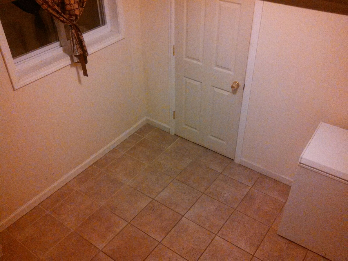 Recently updated tile, paint, and large window, right outside of the room.