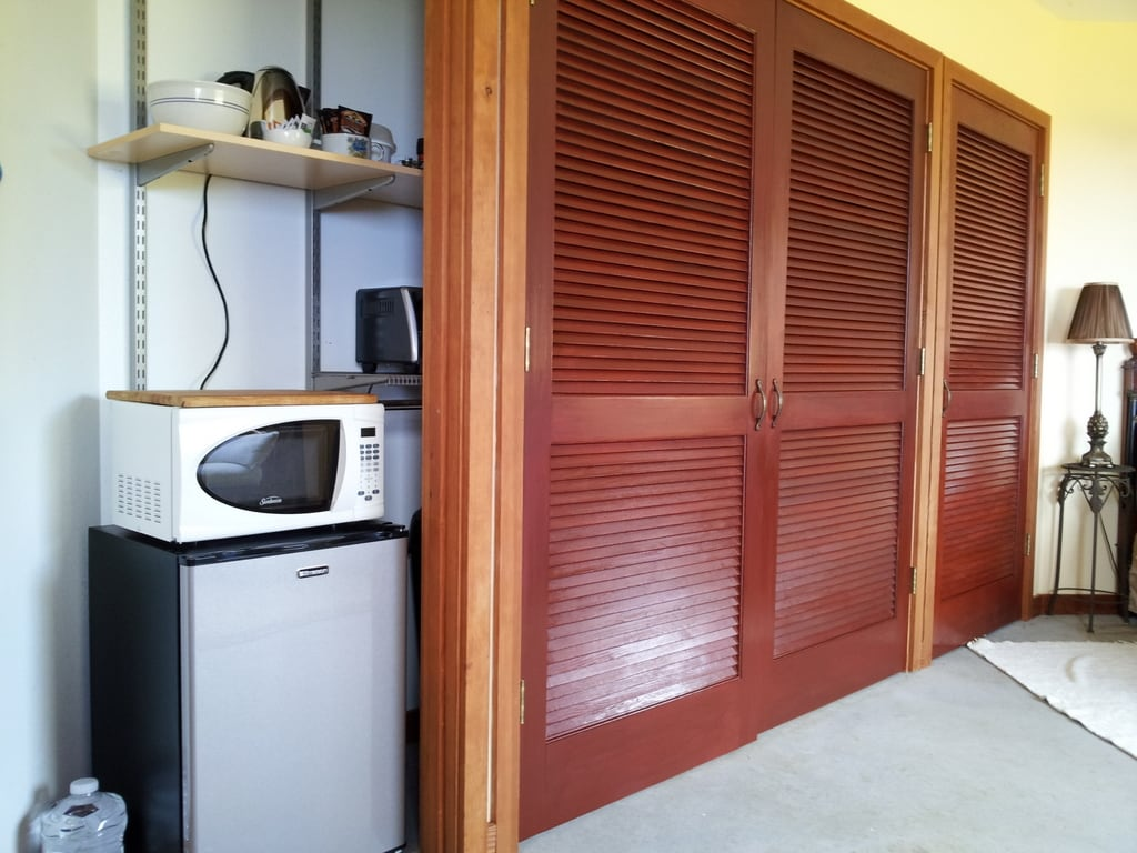 The indoor kitchenette is discreetly tucked into the enormous closet, with small refrigerator, microwave, toaster oven, hot plate, toaster, electric tea kettle and coffee maker.