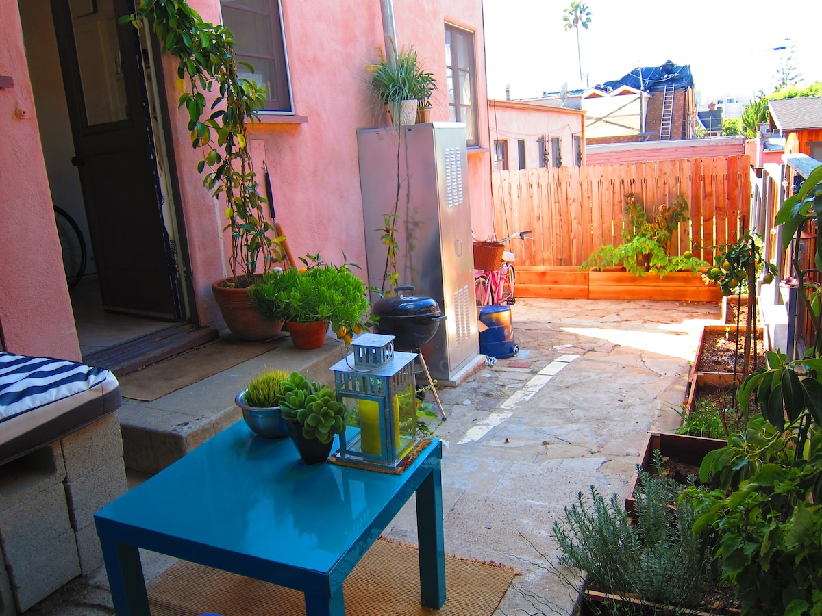 Private garden patio with outdoor dining area… Equipped with a charcoal grill!