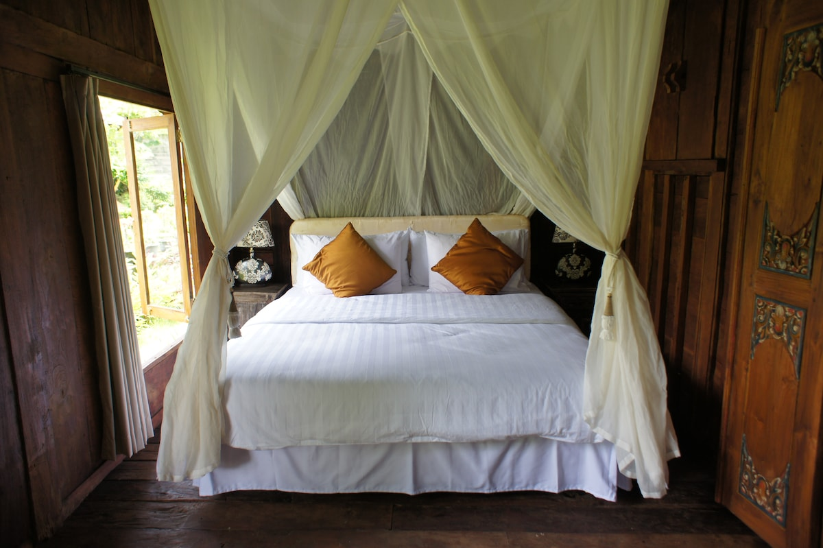 Pool & garden view queen size bedroom with air conditioning, a dressing table and a chest