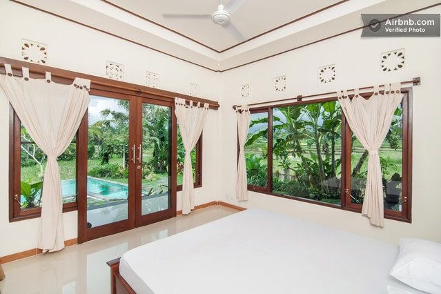 Poolside room in rice field home