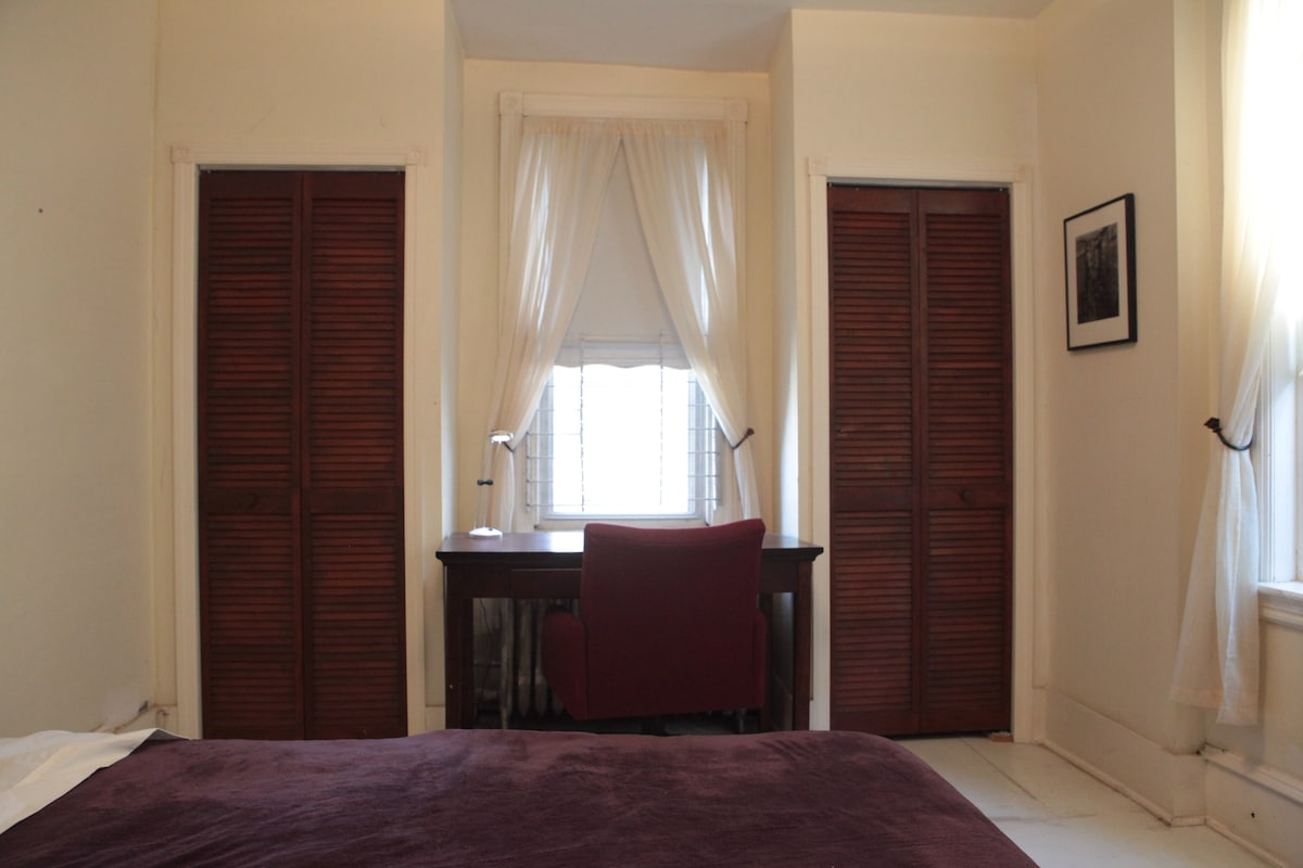 Closets and desk with chair