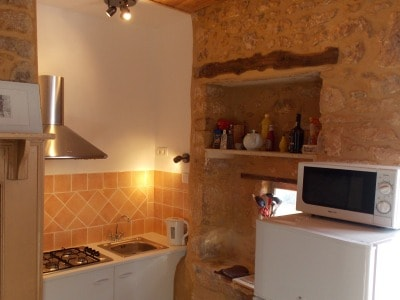 Fully equipped kitchen, windows leading onto the street.