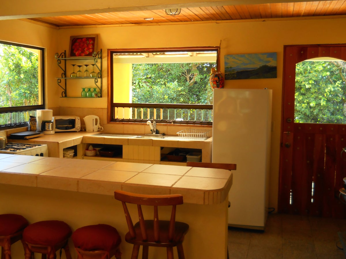 Kitchen area with breakfast counter.
