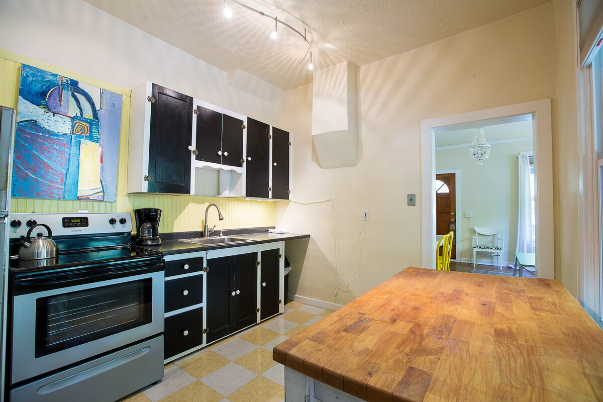 Kitchen with large table for additional counter space.
