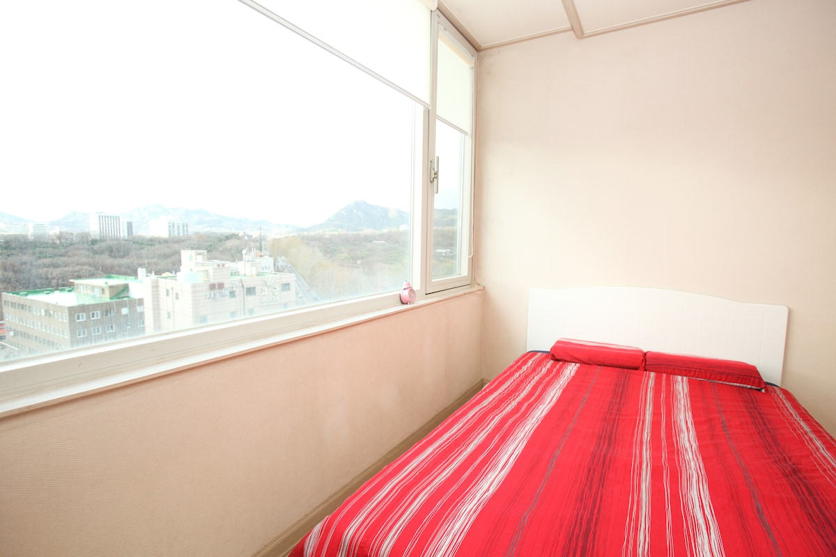 Window with blind beside your bed, can see stars and night view (Seoul tower) when you go to bed