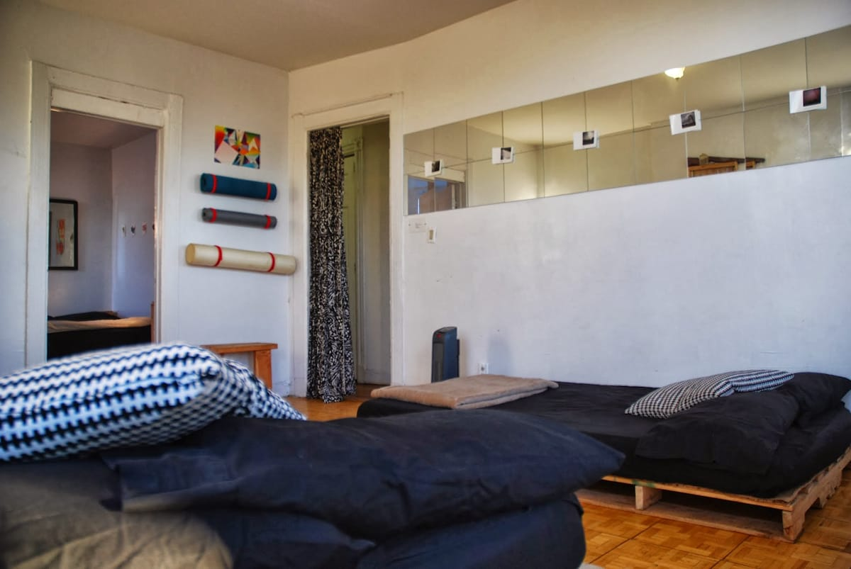 The living room fits two full size beds and still has a comfortable amount of space to move around