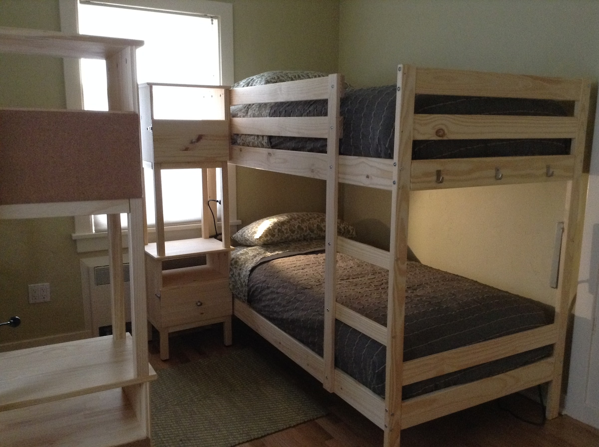 Two twin bunk beds with night stands