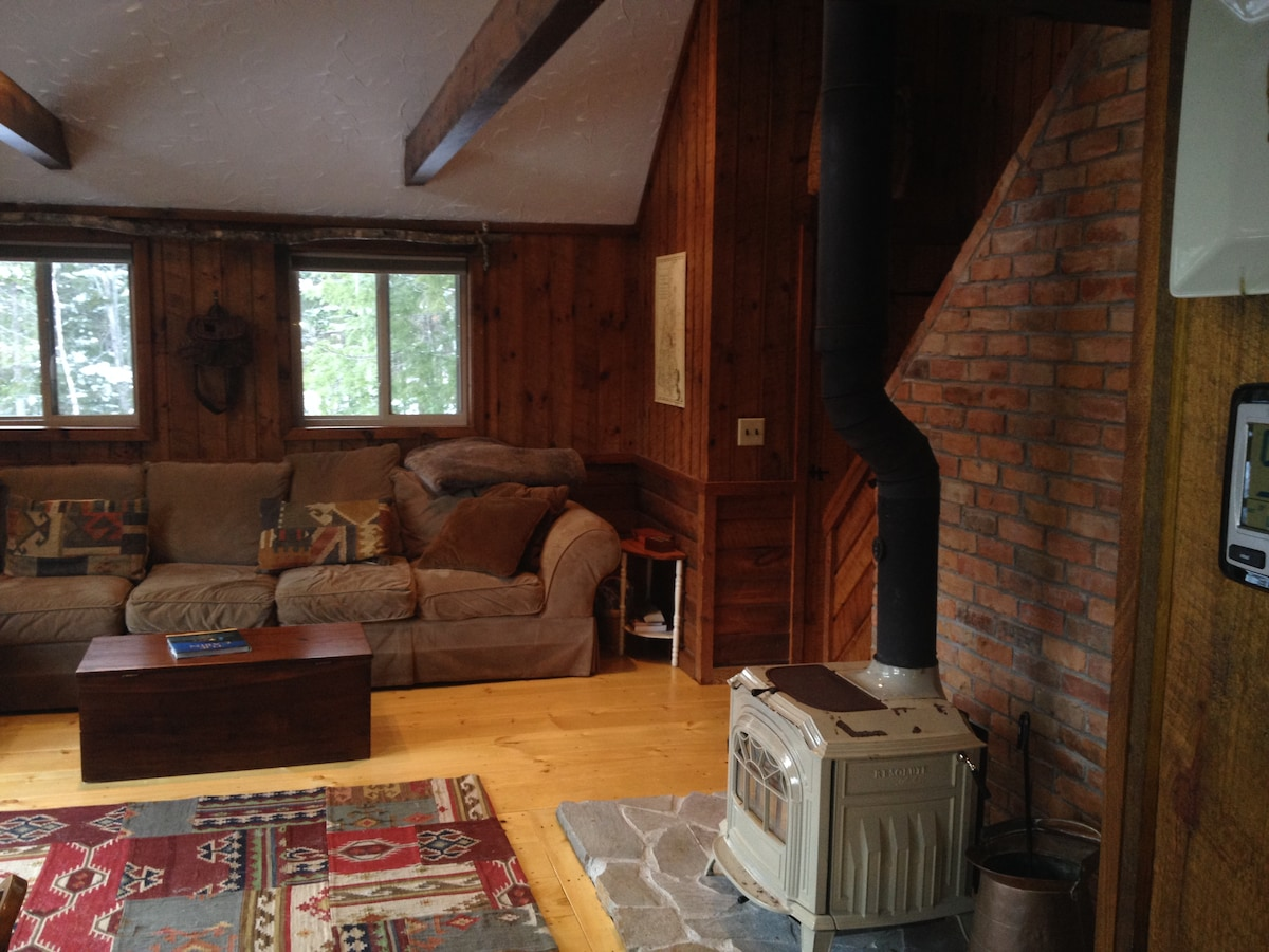 Family Room with New Wide Pine Flooring and Vermont Castings Wood stove