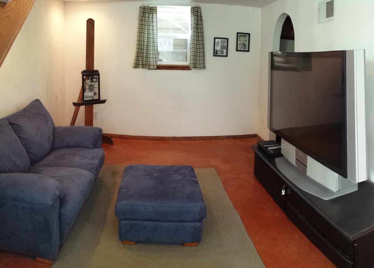 The downstairs family room features a 60 inch TV, DVD player, and Blueray to enjoy movies.