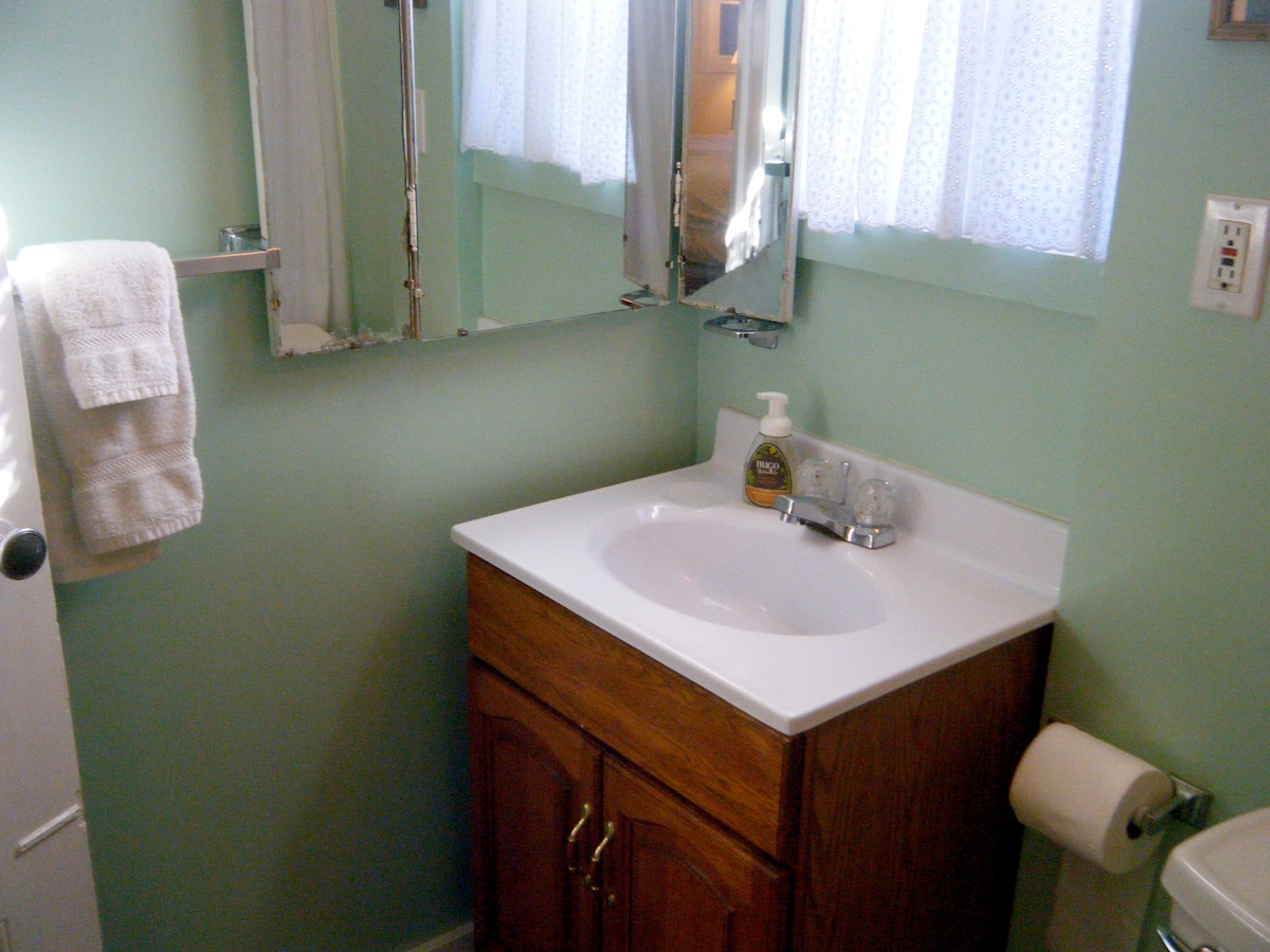Private ensuite bathroom with shower, towels and bath products.