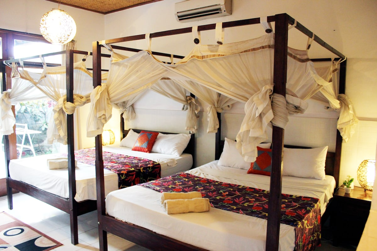 2 Super-Queen Size Beds, both with 4 post frames and mosquito nets, Air Conditioner, Nice Lighting. Lovely Decor.