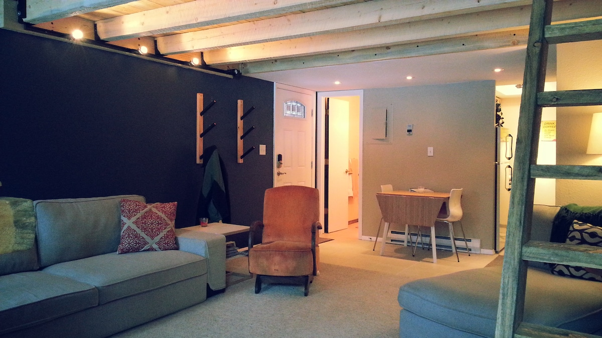 view of living/dining area and ski/snowboard storage