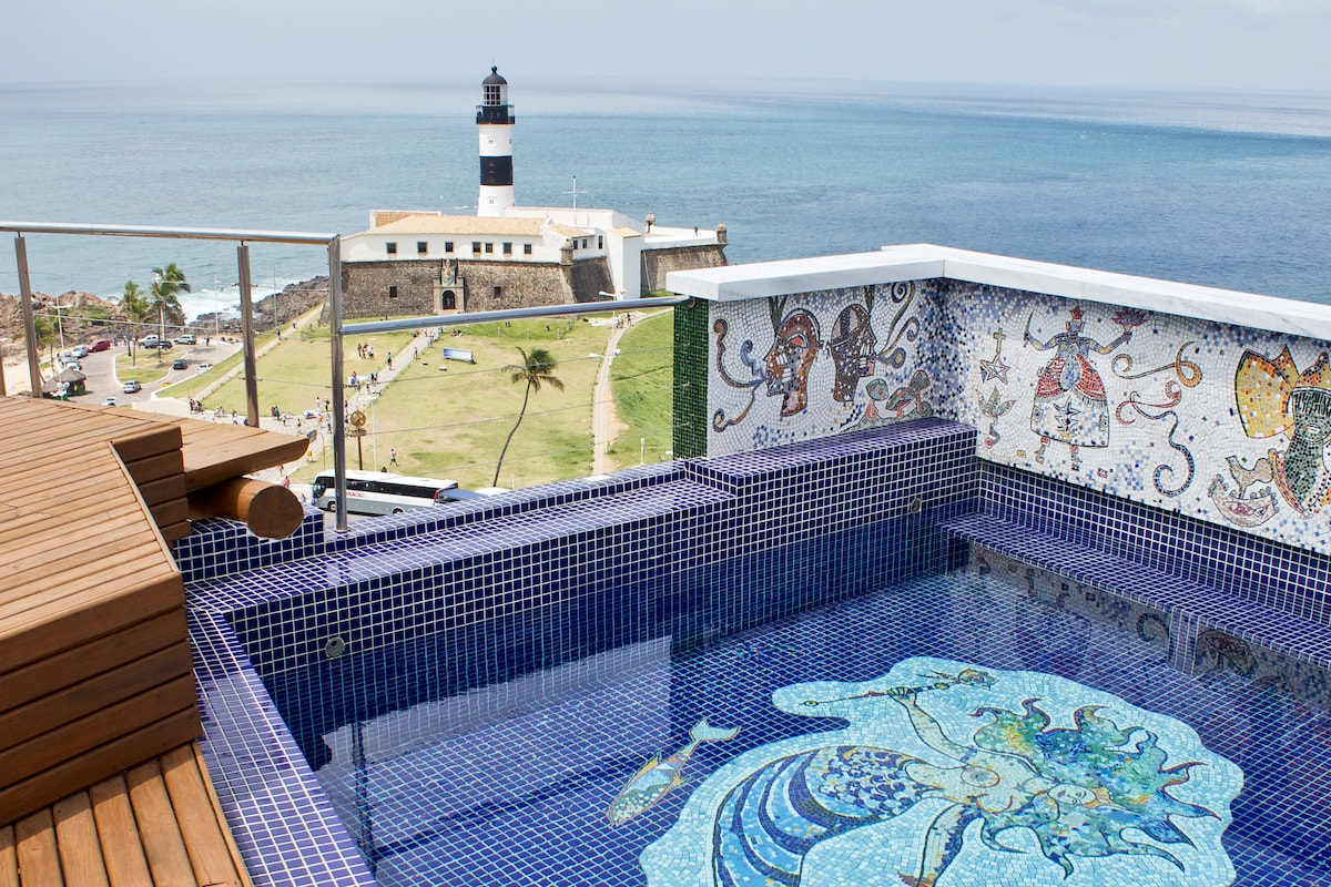 Pool, mosaics of orixás, view of Farol