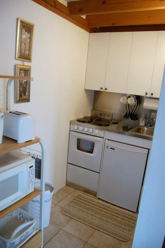 Fully equipped kitchenette includes stove, oven, microwave, toaster, coffee-maker, kettle, mini fridge (with small freezer) and all dinnerware, glassware & utensils.