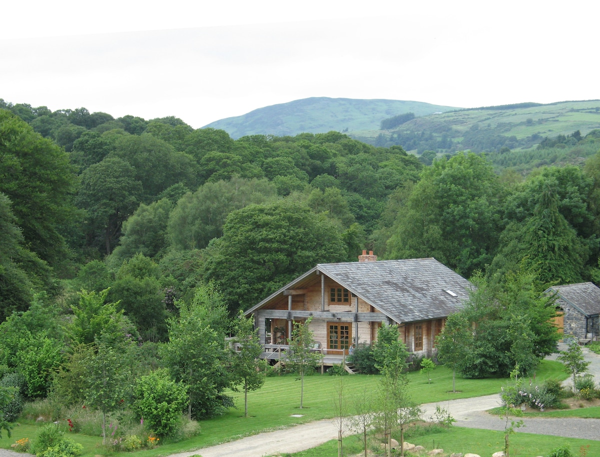Nestling in the wooded landscape of Glenmalure Valley.