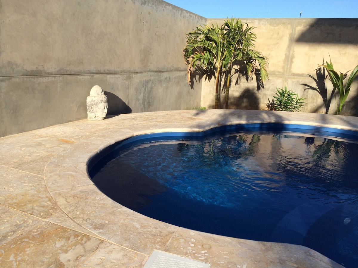 Your private pool with coral stone deck