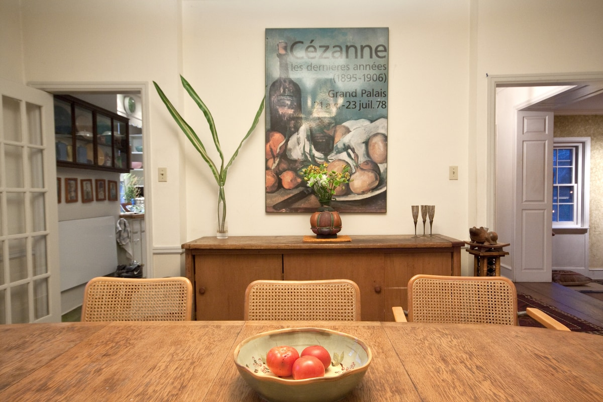 The sight lines are lovely throughout the home.  Dining rm table was built by artist Jimmie Leuders.